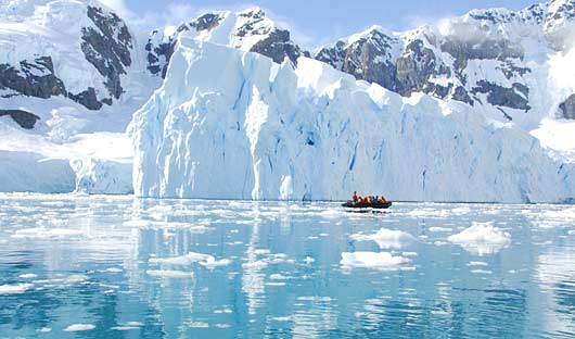 Zodiac and iceberg Antarctic Peninsula