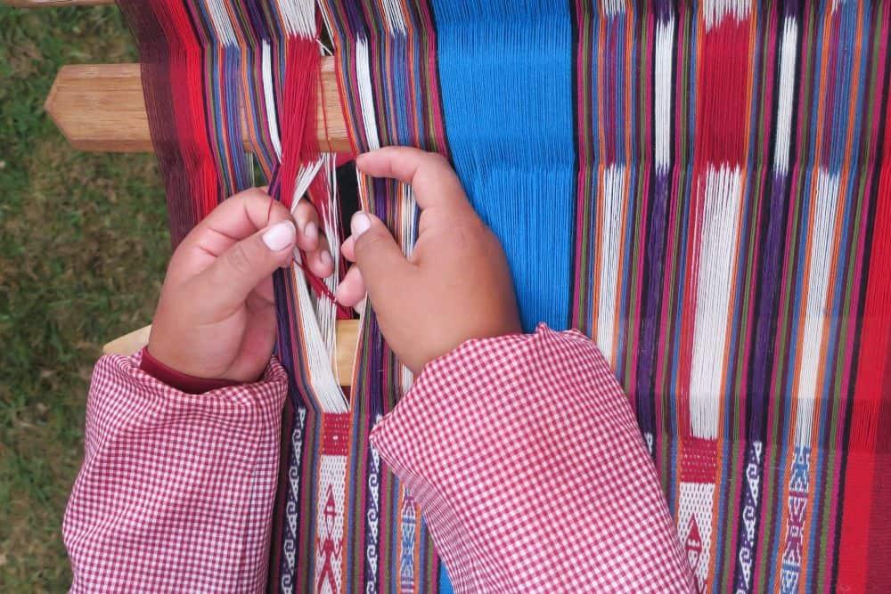 Hand Weaving Chinchero Sacred Valley Peru by Janet Keefe