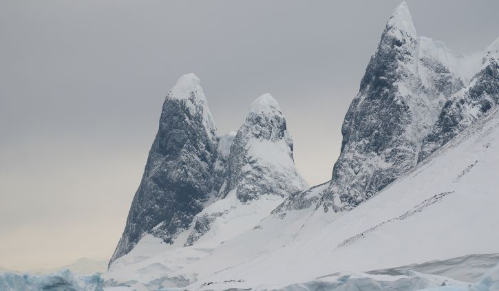 Towering peaks guard the entrance to the Lemaire Channel resize